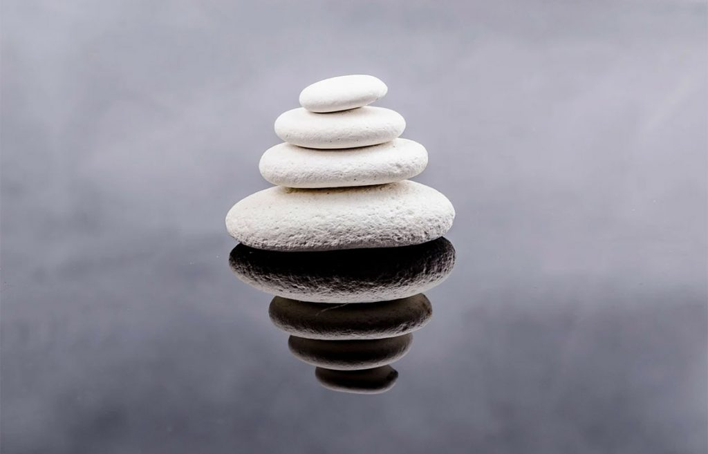 4 zen stones compiled on top of each other